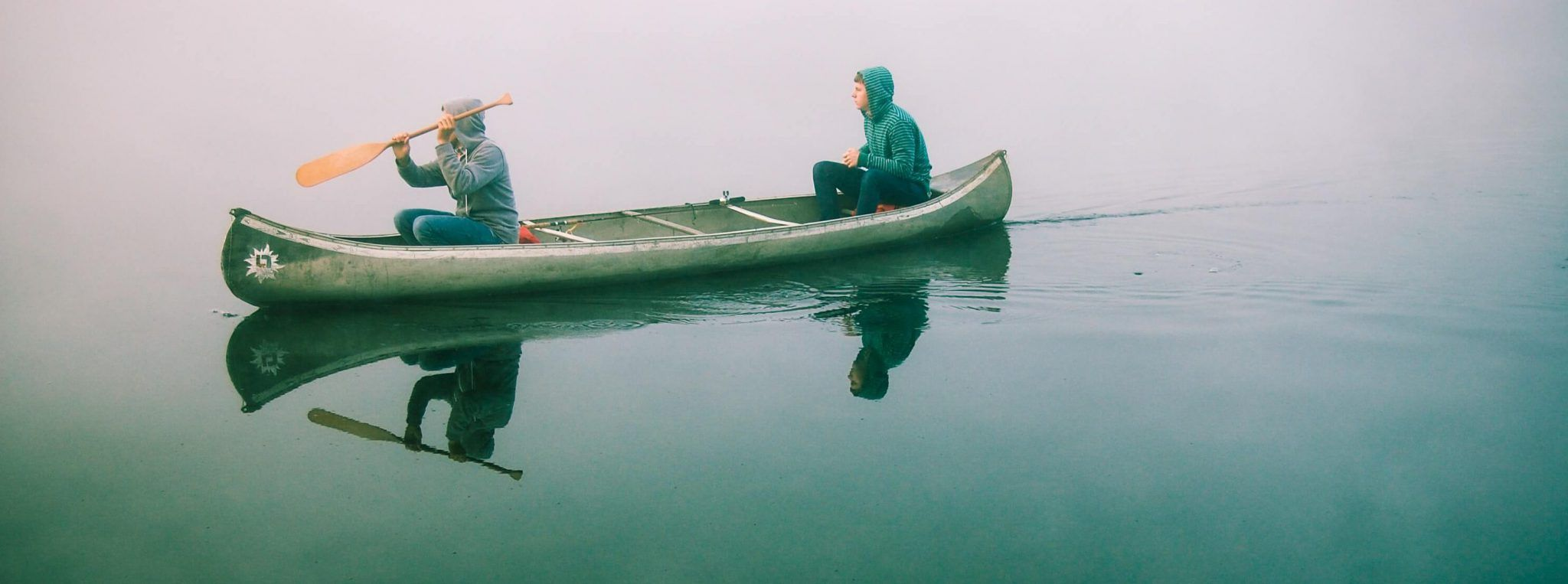 Two people in a canoe on water
