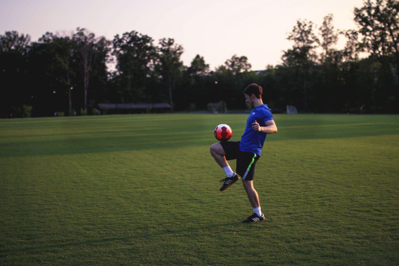 Man dribbling soccer ball on knee