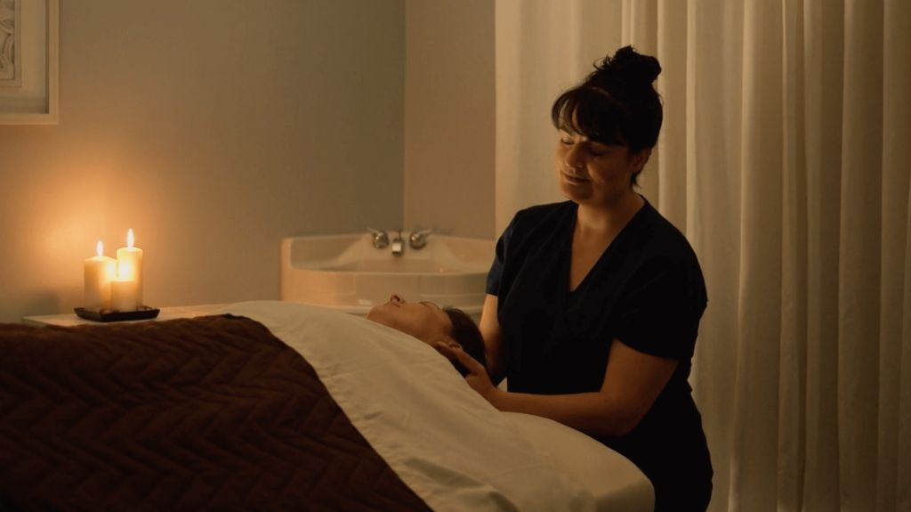 Licensed massage therapist massaging patients neck